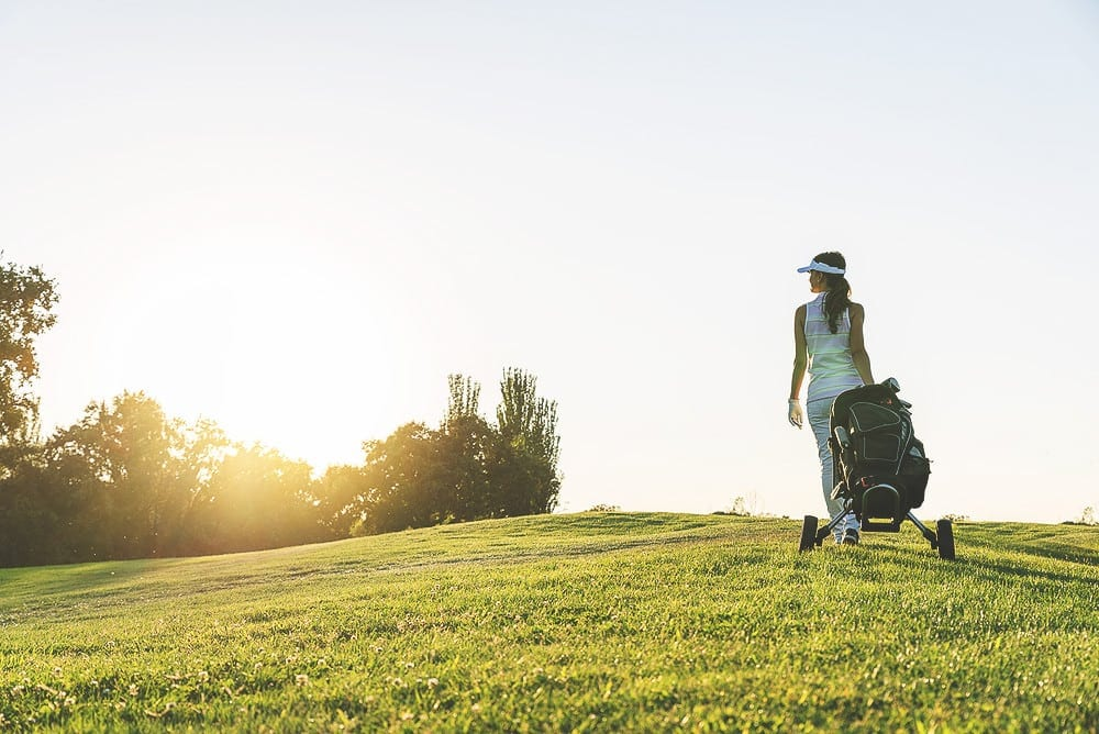 Woman Walking on Golf Course